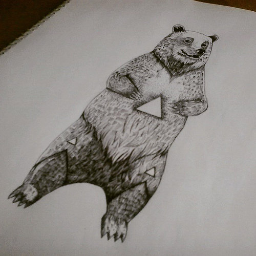 Huge standing bear with triangle holes tattoo design