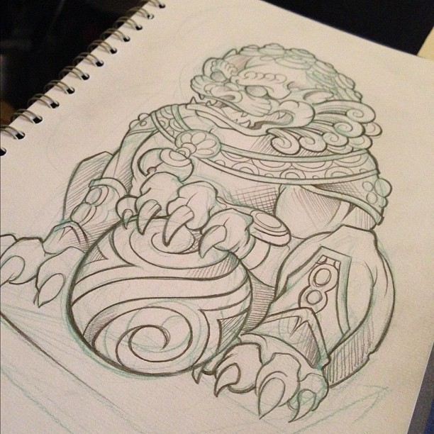 Huge uncolored foo dog with ball under its paw tattoo design
