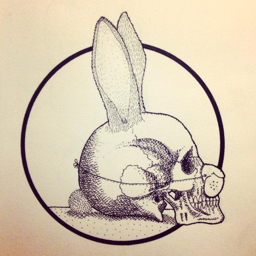 Human skull with rabbit elements in clown nose tattoo design