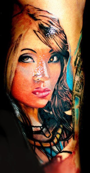 Illustrative like colored arm tattoo of woman portrait