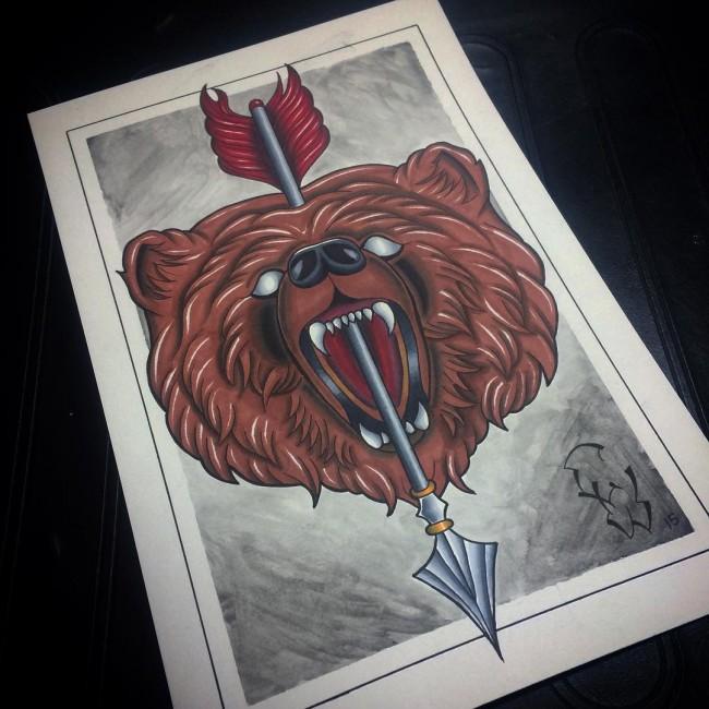 Impressive colorful bear head killed with arrow tattoo design
