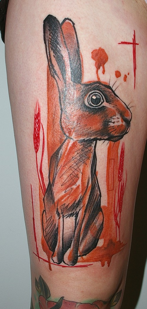 Impressive colorful hare with blooded streaks tattoo on thigh