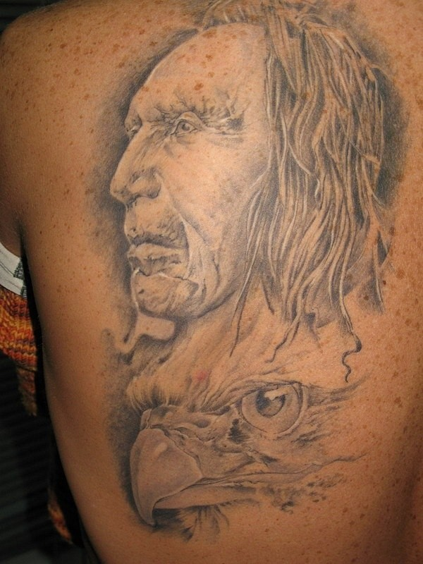 Indian and eagle heads tattoo on back