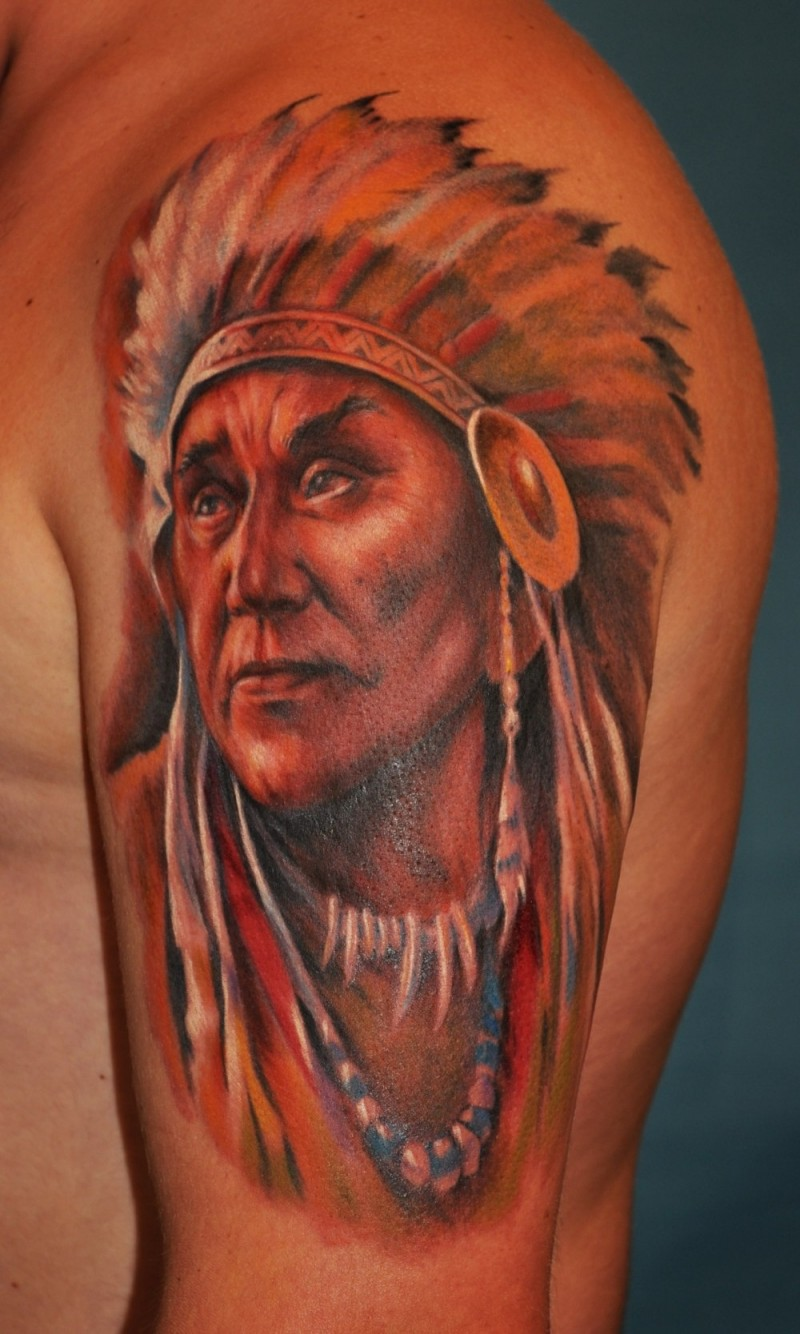Indian with ornaments tattoo on shoulder