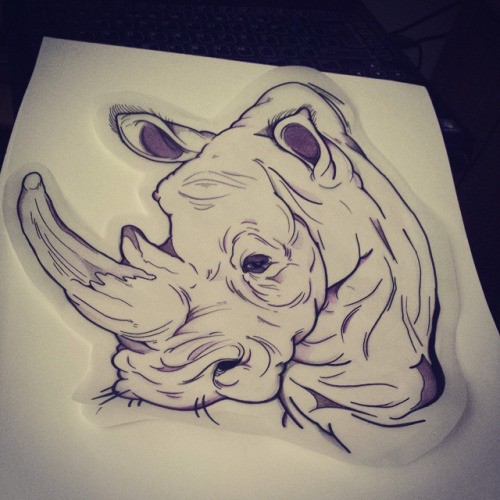 Indifferent uncolored rhino portrait tattoo design