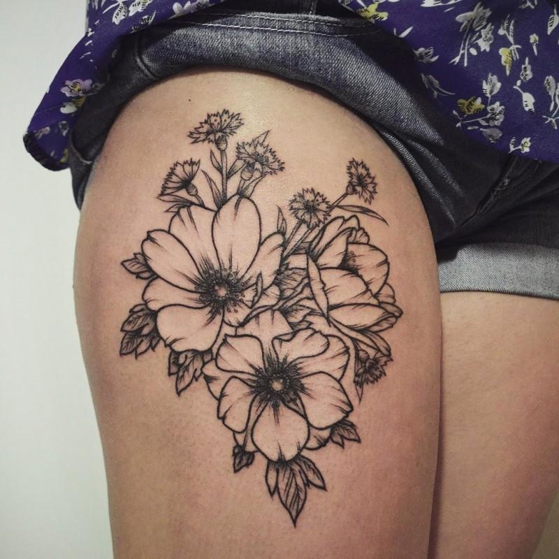 Interesting black-contour flowers tattoo on thigh