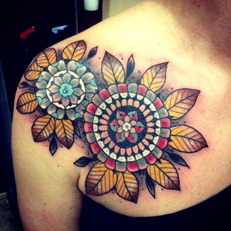 Interesting designed colorful old school mandala flower with leaves tattoo