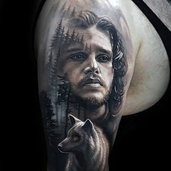 John Snow with wolf tattoo on half sleeve by Arlo