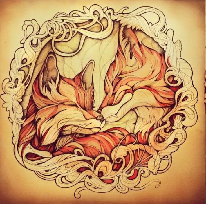 Kissing red fox couple in curled frame tattoo design