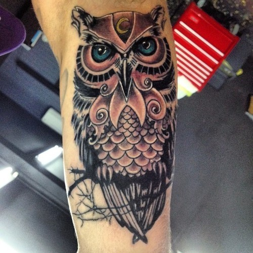 Large cool mens colorful owl tattoo on forearm