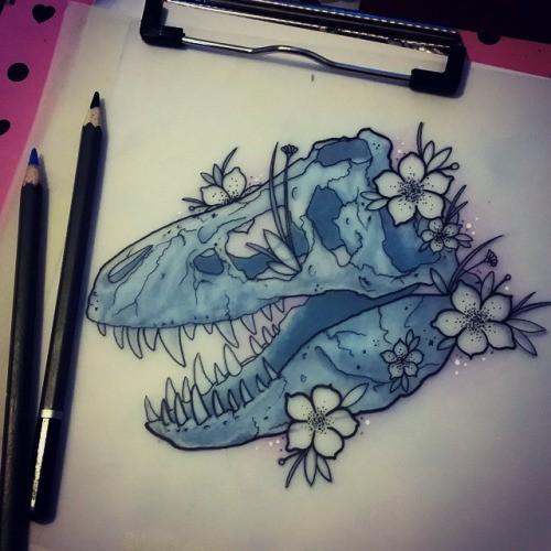 Light blue dinosaur skull with little white cherry flowers tattoo design