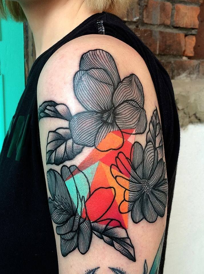 Linework style colored by Mariusz Trubisz upper arm tattoo of large flowers