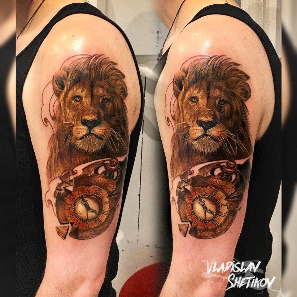 Lion an old clock tattoo on shoulder