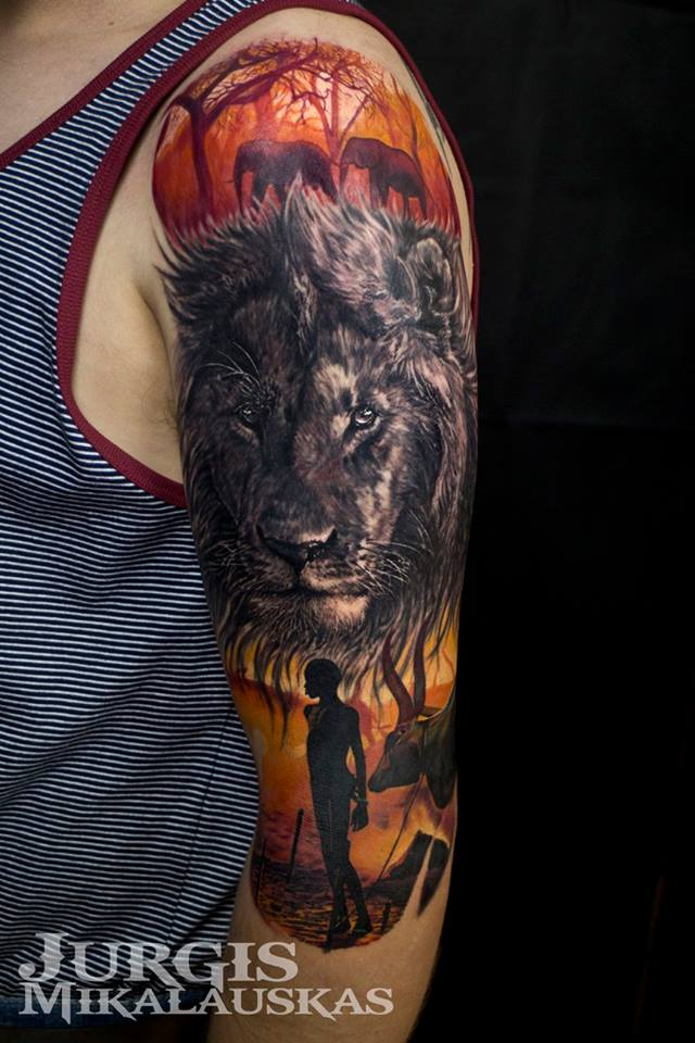 Lion and africa theme tattoo on arm