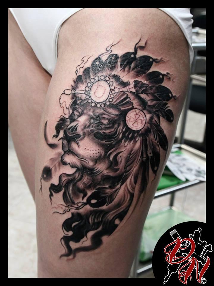 Lion in War bonnet tattoo on thigh