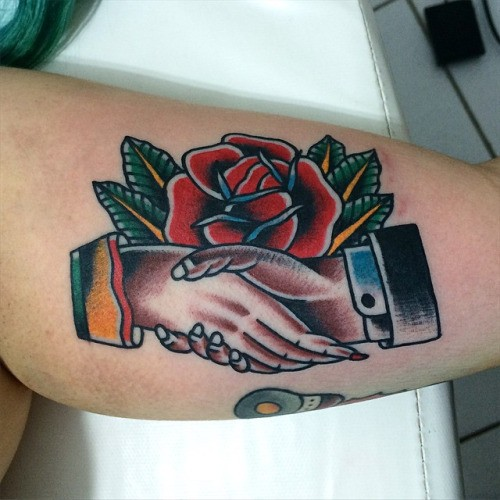 Little american classic tattoo with handshake and rose