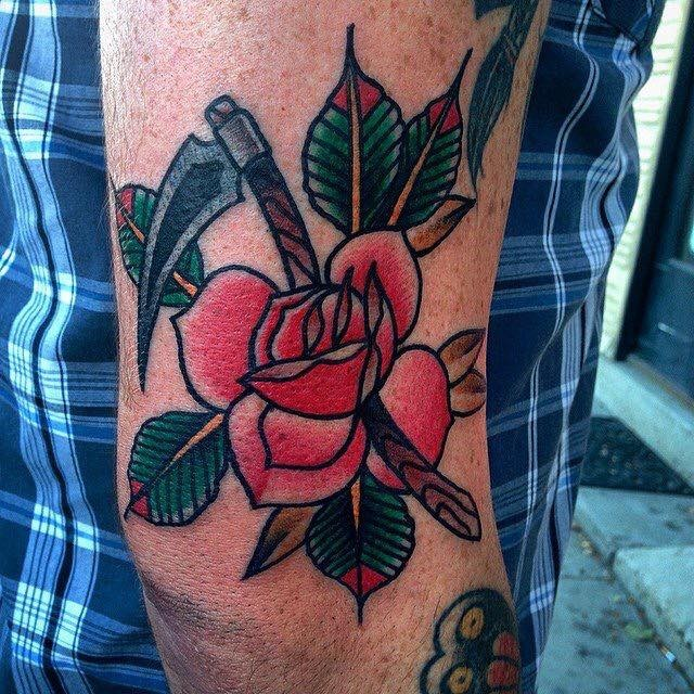Little american classic tattoo with rose and scythe on elbow