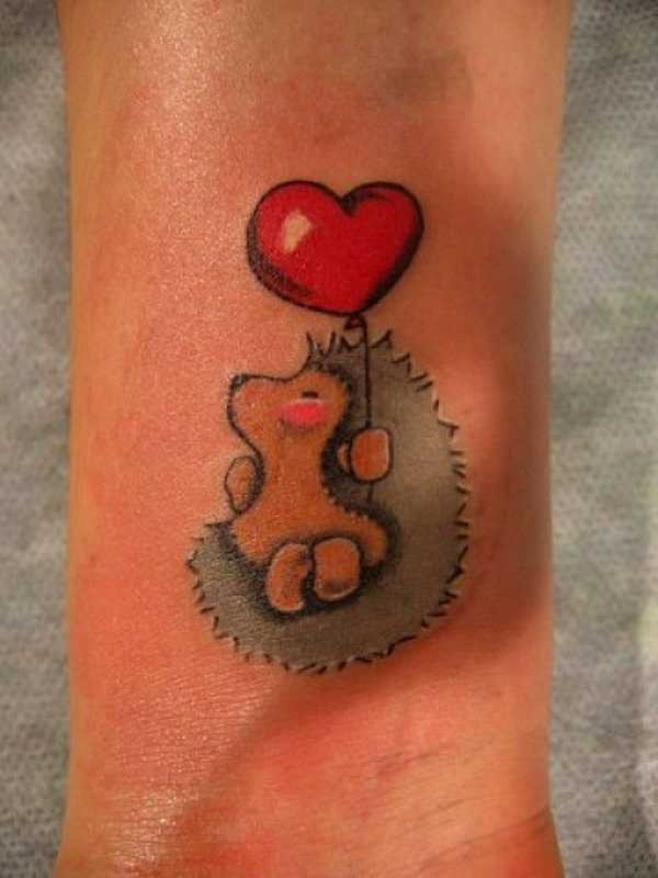 Little Girly Hedgehog With Red Heart Balloon Tattoo On Arm