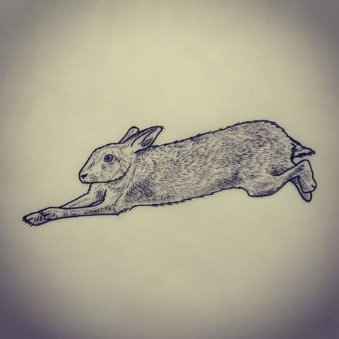Little grey-ink hare frozen in motion tattoo design