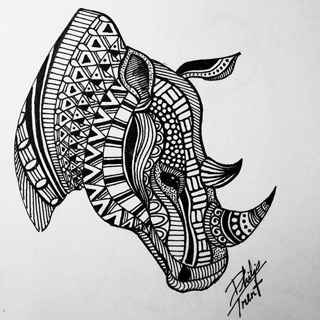 Lovely black-ink rhino head with geometric ornament tattoo design