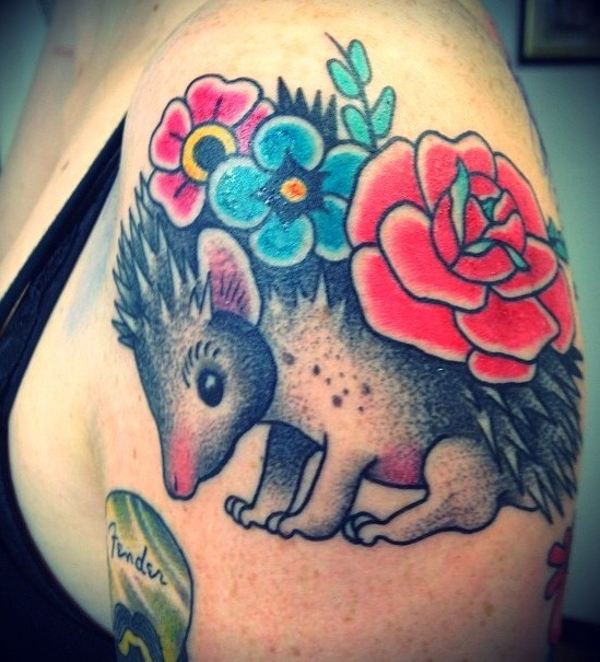 Lovely colorful hedgehog with flowers tattoo on shoulder