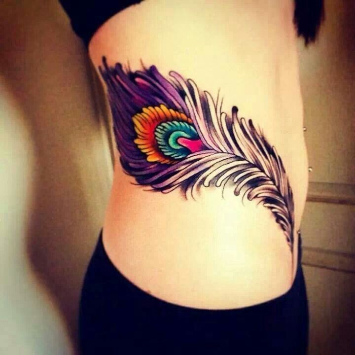 Lovely colorful peacock feather tattoo on side