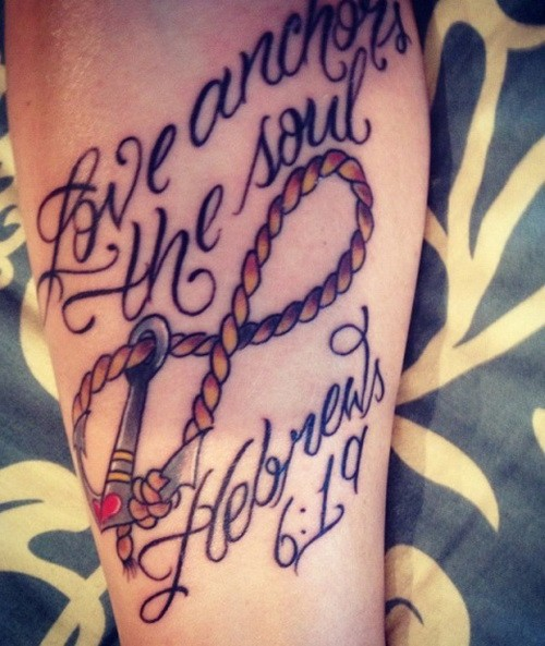 Lovely female roped anchor infinity with lettering tattoo on forearm
