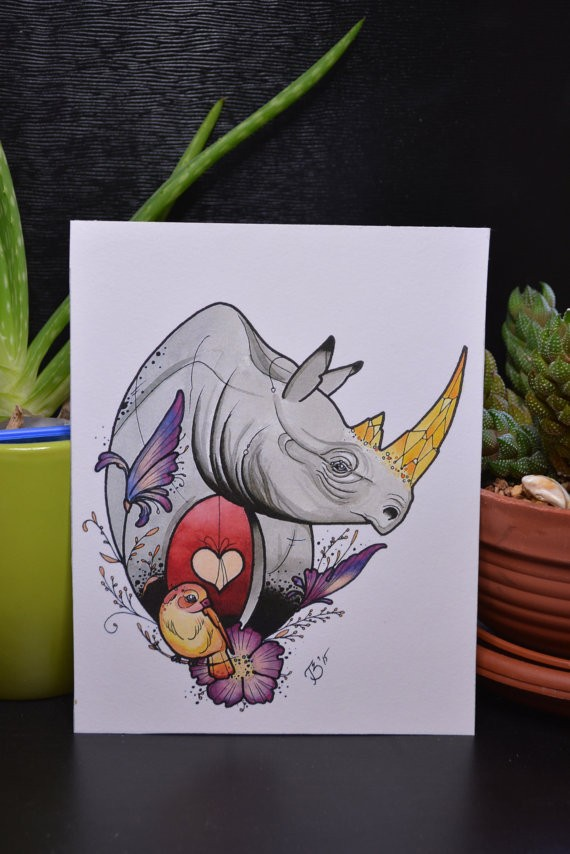 Lovely grey rhino with yellow horns and tiny orange bird tattoo design