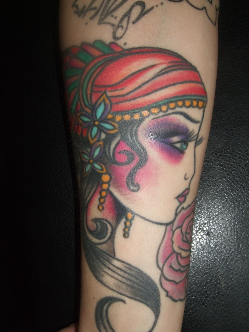Lovely gypsy girl head tattoo for guys on forearm for Girl head tattoo