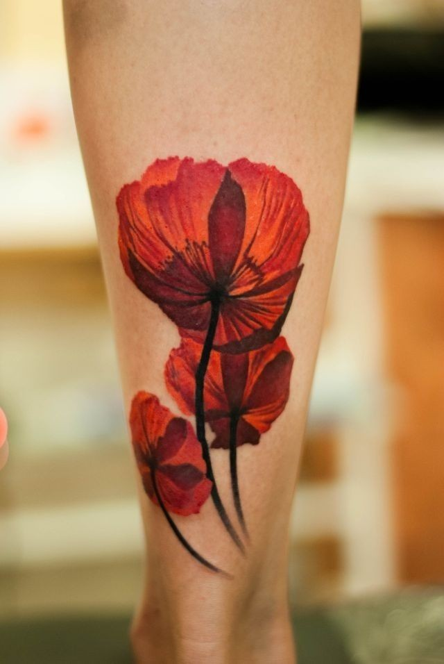 Lovely poppy flowers tattoo on shin