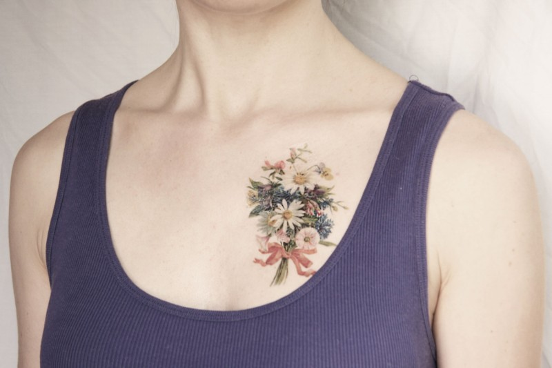 Lovely tender vintage flower bouquet tattoo on chest