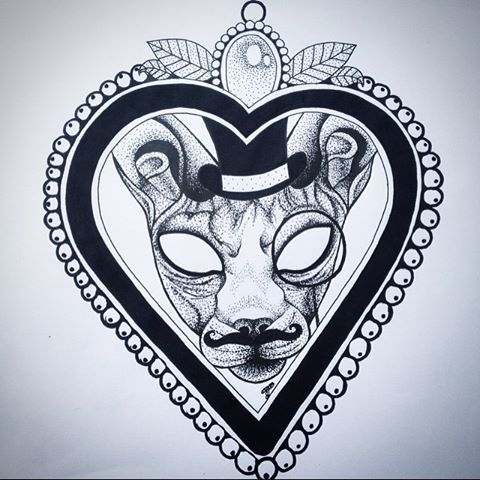 Mad-eyed sphynx cat in thick beaded heart frame tattoo design