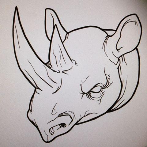 Mad uncolored rhino head tattoo design