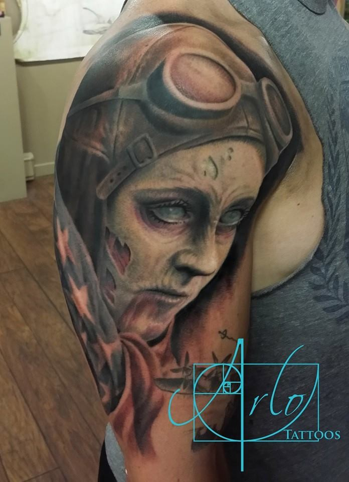 Marvelous detailed painted upper arm tattoo of zombie woman pilot