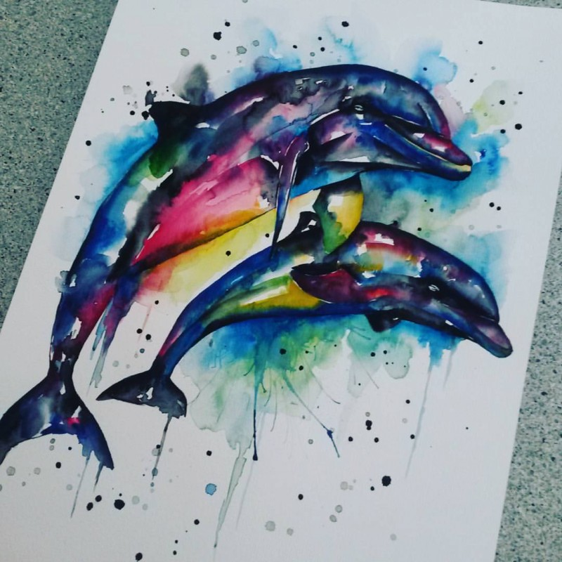 Marvelous rainbow watercolor jumping dolphin couple tattoo design