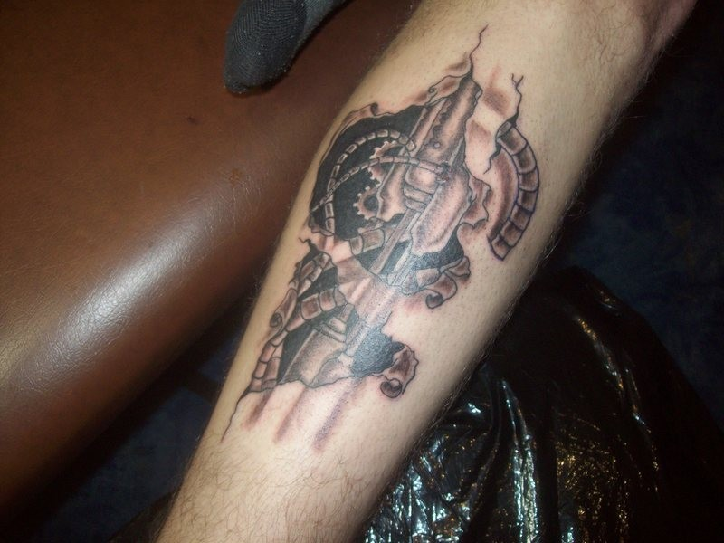 Mechanical cogwheels and wires under skin tattoo on arm for Skin gallery tattoo