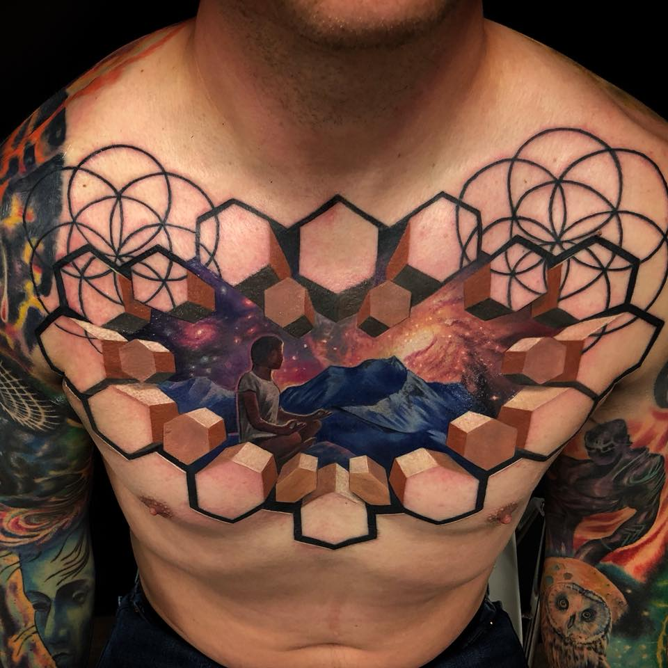 Meditating man tattoo on chest with 3d style hexagons
