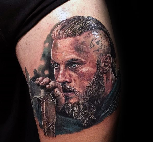 Mens Ragnar portrait tattoo on thigh