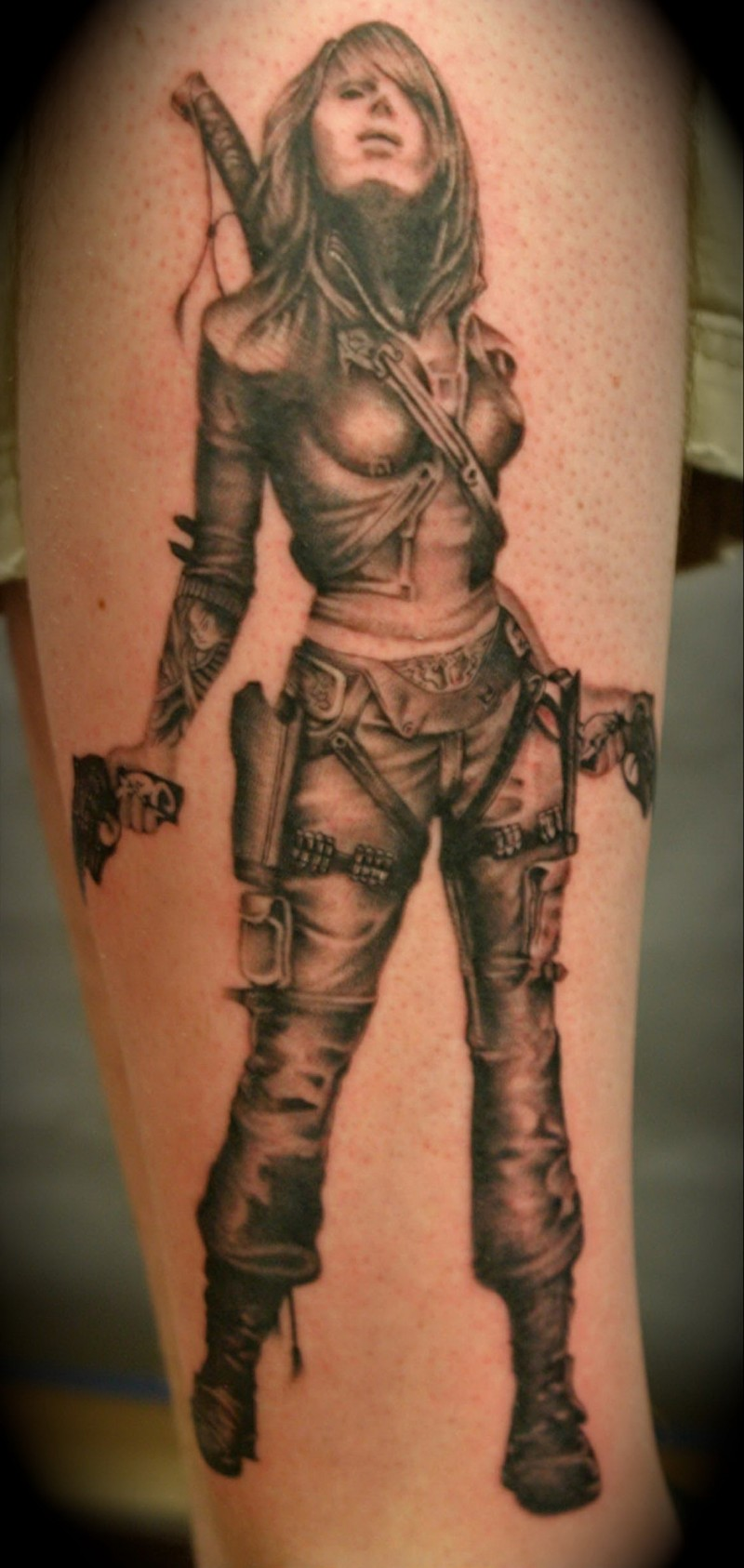 Modern girl warrior with guns tattoo on shin