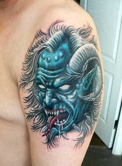 Modern style colored upper arm tattoo of blue monster with horns