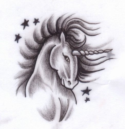 Modest grey-ink unicorn head among tiny stars tattoo design