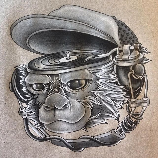 Monkey head with playing music plate tattoo design