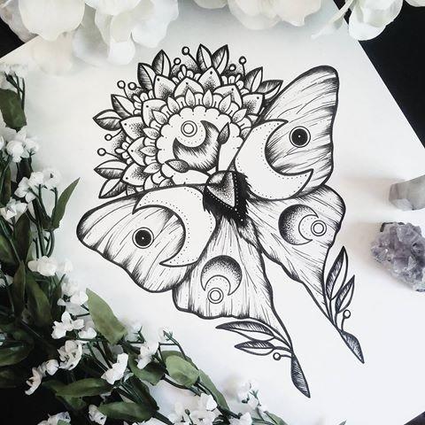 Moon-patterned moth on half-mandala background tattoo design