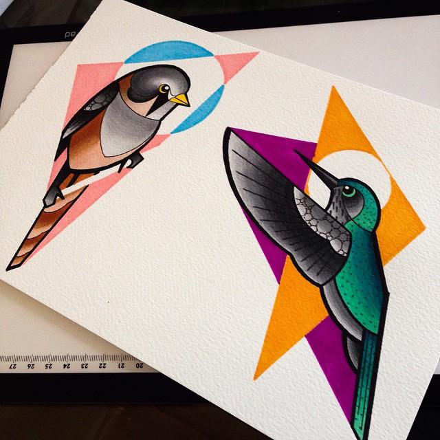 Multicolor birds on geometric colorful figures tattoo design