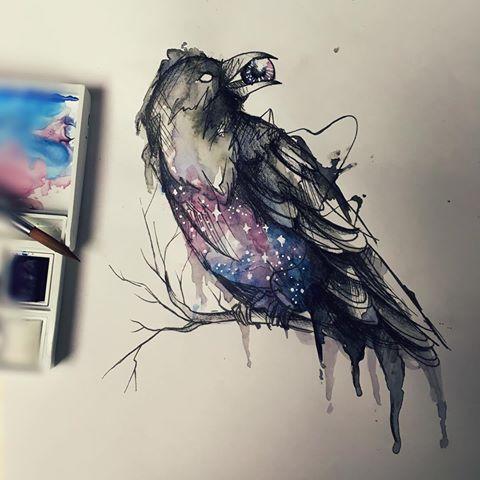 Mystic space-patterned raven keeping an eye in a beak tattoo design