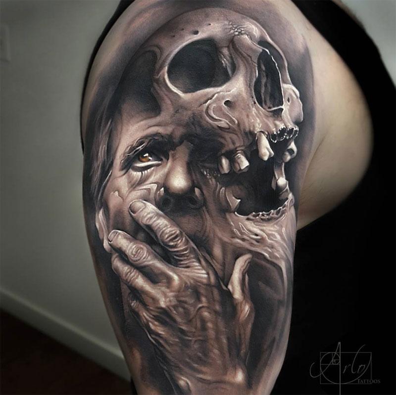 Mystical men with skull tattoo on shoulder