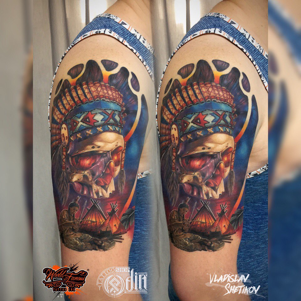 Native american style skull tattoo on shoulder