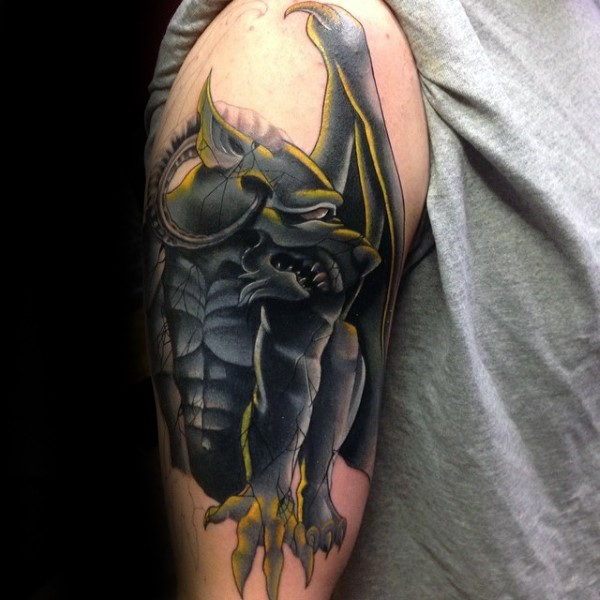 New school cool painted upper arm tattoo of stone gargoyle statue
