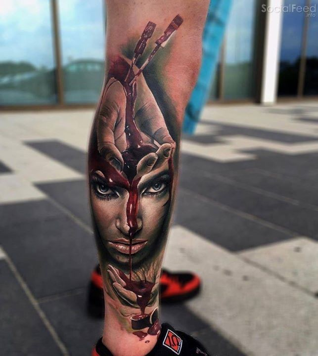 New school style bloody leg tattoo of woman face with bloody hands