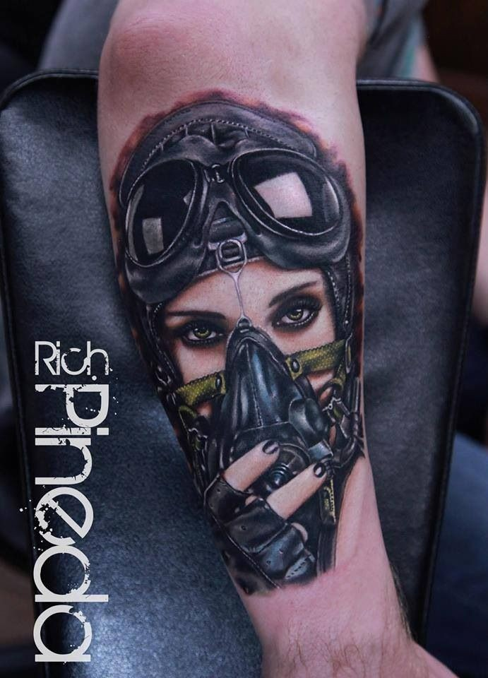 New school style colored arm tattoo of seductive woman pilot